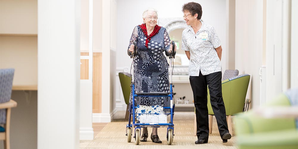 beauaraba_living_brookstead_and_pampas_houses_resident_walking_with_staff_member
